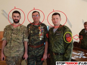 On the photo: number 1 denotes Russian MP Denis Ahromkin, number 2 – commandant of LPR, Sergey Grachev, number 3 – Igor Mangushev, leader of the patriotic youth movement 'Lucid Rus', which is the part of the Russian PMC 'E.N.O.T. CORP'. Also chevrons of commandants of LPR and chevrons of 'New Russia' are highlighted in yellow. Photo credit: Stop Terror