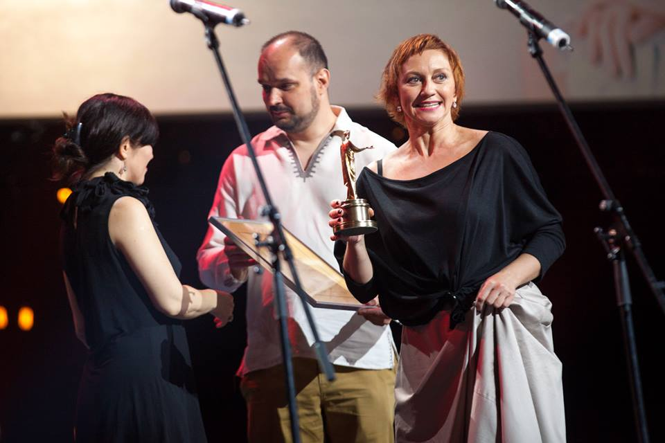 Film director Taras Tkachenko and main actress Rymma Zyubina receive an award for the best Ukrainian film at the Odesa International Film Festival