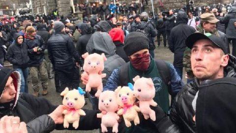 Toy pigs against curruption in Ukraine defense sector